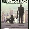 Deux âmes en noir sur un toit blanc